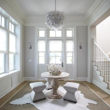 Round Center Of Foyer Table With White Cowhide Rugs