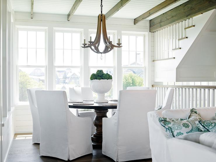 Beach Style Dining Room With Round Dining Table And White