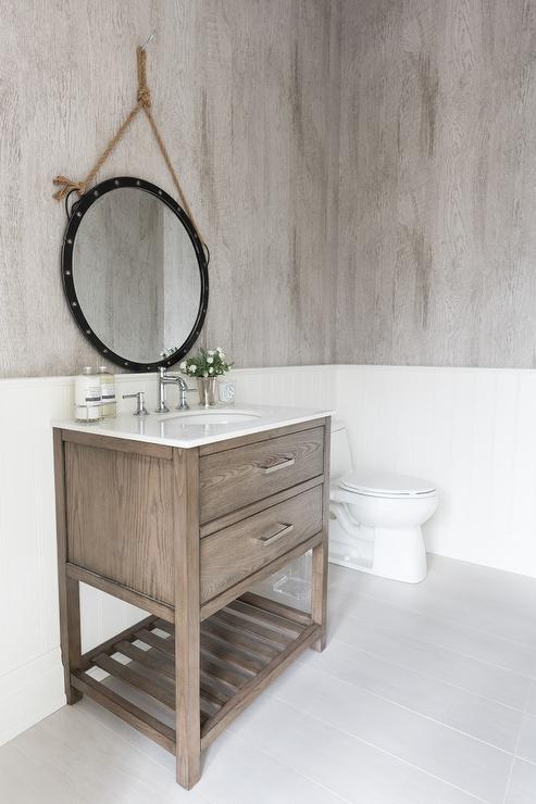 Faux Bois Wallpaper aqua blue powder room with white faux bois mirror - transitional