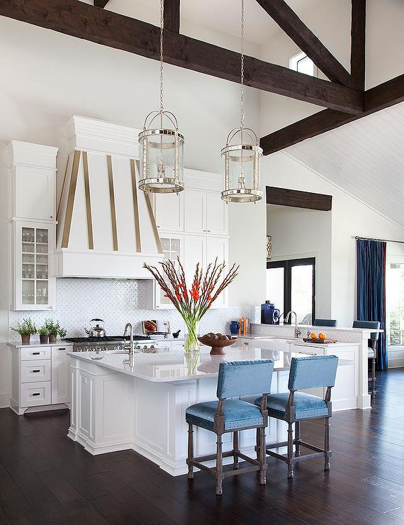 Kitchen With Dark Stained Truss Ceiling And Round Mirrored