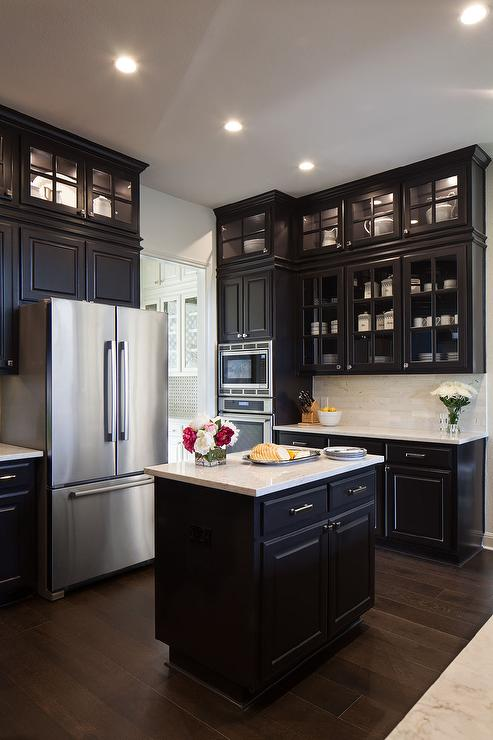 Black KItchen Cabinets With Glass Front Doors That Go All The Way Up To The  Ceiling