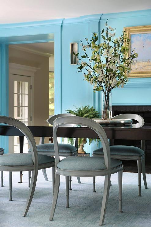Oval Black Dining Table With Gray Open Back Chairs
