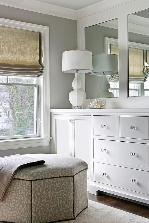 Dressing Room With Built In Cabinets Adorned With Glass