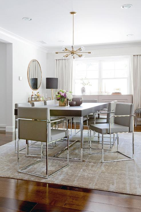 Contemporary Dining Room Features A Brass And Glass Sputnik Chandelier Illuminating Wood Chrome Table Lined With Gray Leather Chairs