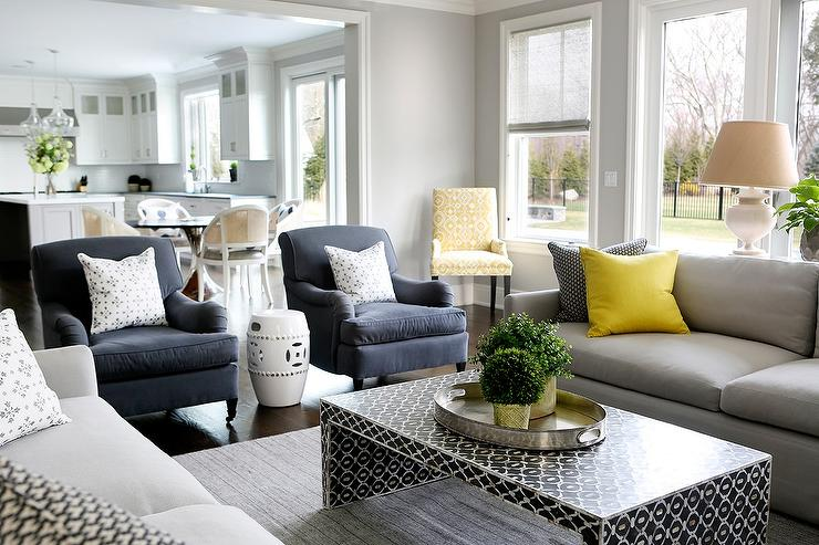 Gray sofa with bright yellow pillows and black waterfall coffee table transitional living room Gray blue yellow living room