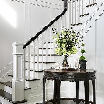 Wainscoted Staircase Wall With Round Foyer Table