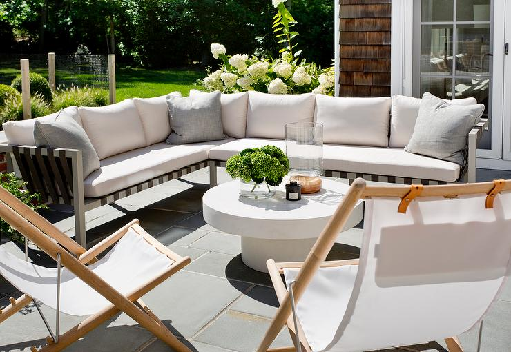 Outdoor Sectional With Folding Chairs And White Pedestal Coffee Table