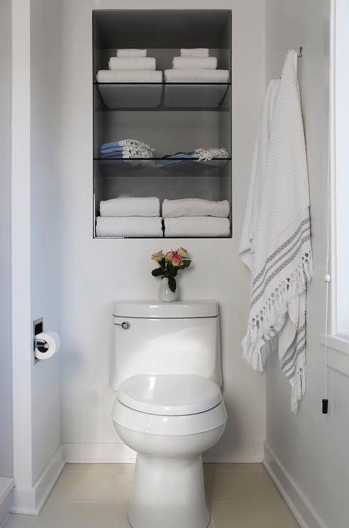 Recessed shelves over toilet transitional bathroom for Bathroom over the toilet shelf