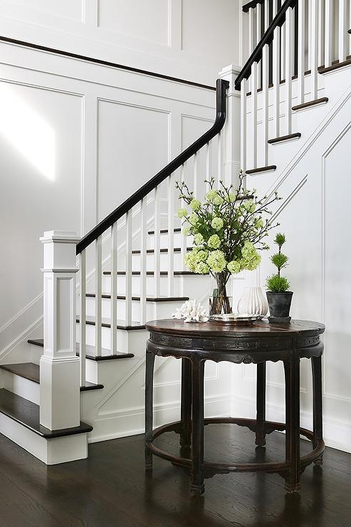 Round Pedestal Table Under Winding Staircase Transitional