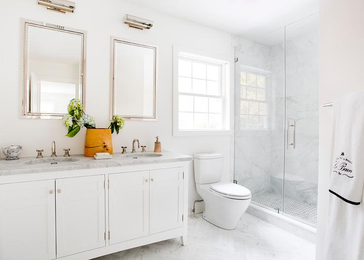 white master bath with white marble chevron floor tiles