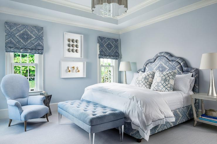 blue bedding as well as blue trellis pillows flanked by open gray