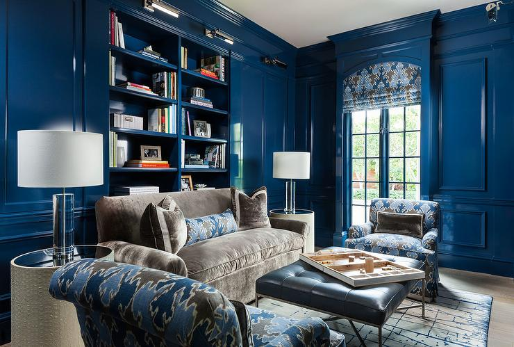 Blue Lacquered Paneled Den With Gray Sofa And Blue Chairs