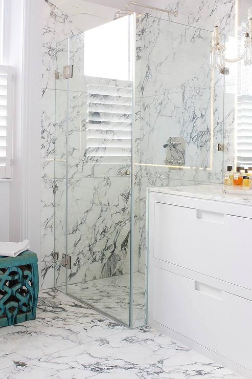 Stunning Bathroom Features A White Dresser Like Washstand Atop A White And  Gray Marble Tiled Floor.