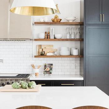 Black Kitchen Island With Pure White Quartz Countertop