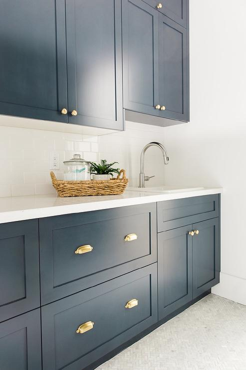 Beautiful Navy Blue Laundry Room Features Navy Blue Shaker Cabinets Adorned With  Brass Cup Pulls Paired With A White Quartz Countertop And A White Subway  Tiled ...