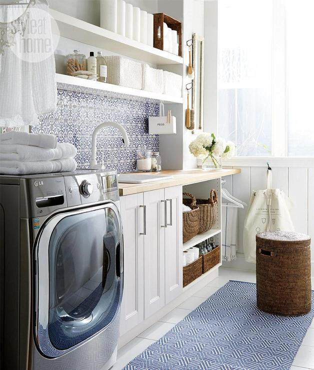 White and Blue Laundry Room with Blue Mexican Mosaic Backsplash