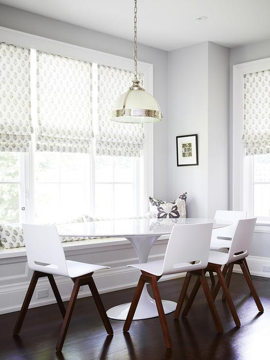 White Oval Dining Table With Black Dining Chairs