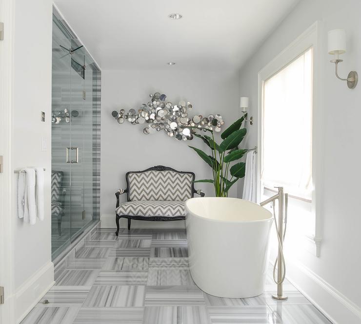 gray bathroom with gray chevron french settee