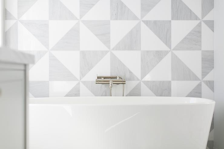 White And Gray Geometric Bathroom Tiles With Modern Tub Filler
