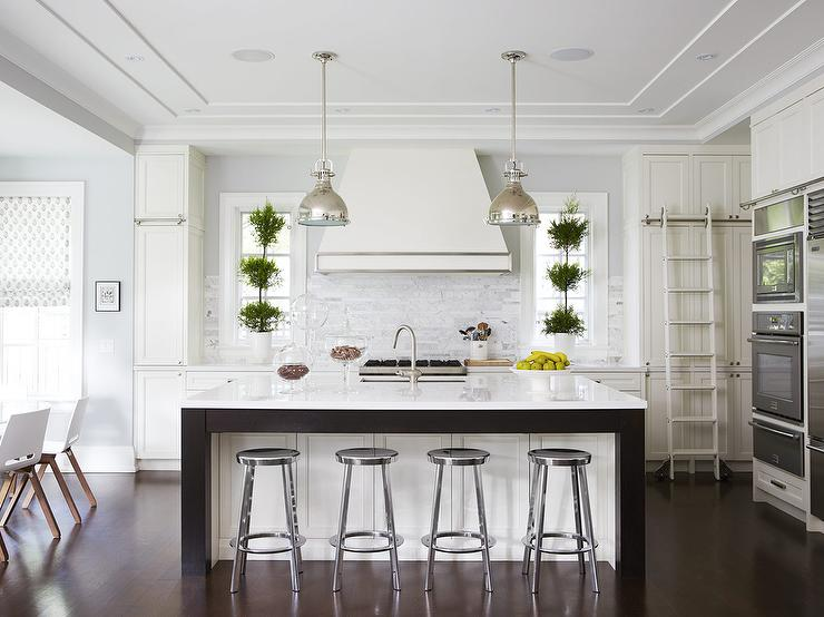 White Wood Kitchen Floor white kitchen with dark wood floors and industrial counter stools