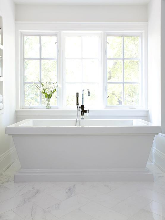 White Pedestal Bathtub With White Marble Chevron Floors