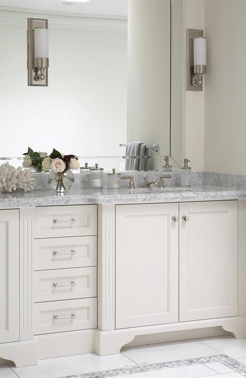White And Gray Bathroom With Carrara Marble Countertops