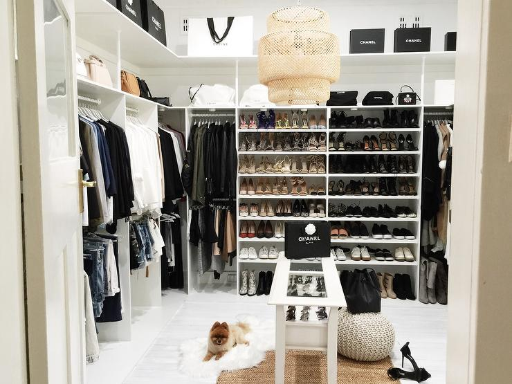 Beau Extra Bedroom Turned Walk In Closet Features A White Modular Closet System  Boasting Clothes Rails, Shoe Shelves And Bag Shelves Lined With Chanel Bags  And ...