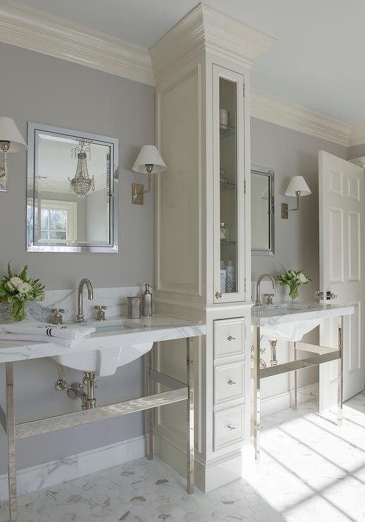 Ivory And Gray Bathroom With Tall LInen Cabinet Between His And Hers  Washstands