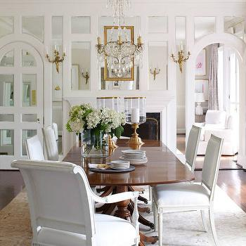 Dining Room With Antiqued Mirrored Fireplace Wall