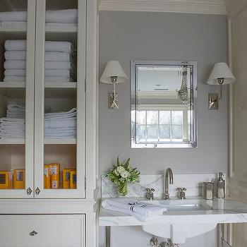 Delightful Ivory And Gray Bathroom With Glass Door Linen Cabinet