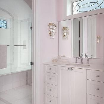 Pale Pink Girls Bathroom With White Capiz Wall Sconce