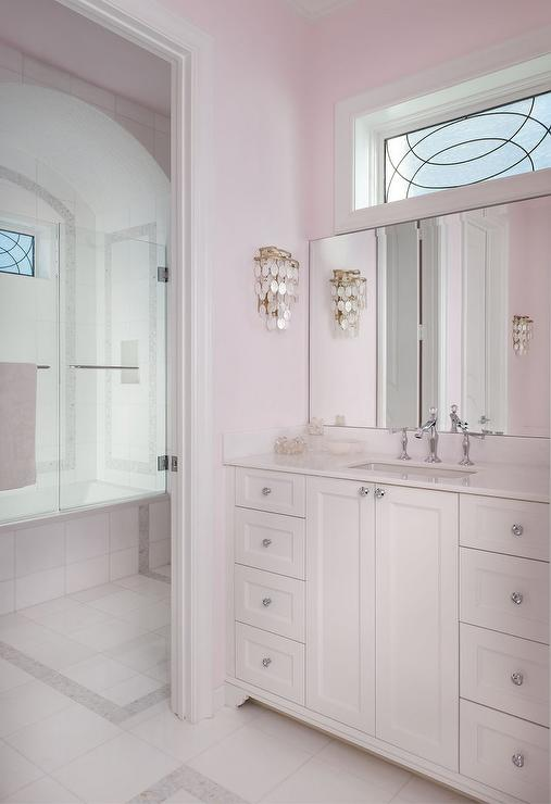 Pale pink girls bathroom with white capiz wall sconce for Girls bathroom ideas