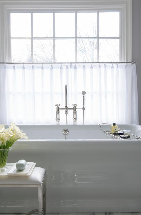 privacy for bathroom window over tub decorative window.htm waterworks bathtub under window dressed in white cafe curtains  window dressed in white cafe curtains