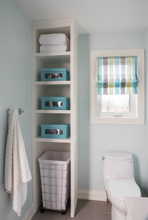 Kids Bathroom With Tall Shelving Unit With Rolling Hamper Transitional Bathroom