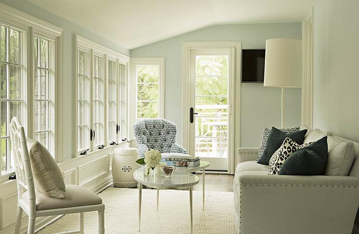 White And Blue Sunroom With Marble Kidney Shaped Coffee Table