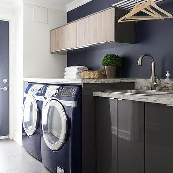 Charming Gray Lacquered Laundry Room Cabinets With Blue Front Load Washer And Dryer