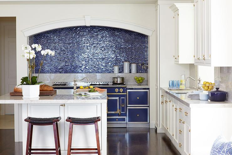 white and blue kitchen with blue glass iridescent tile backsplash