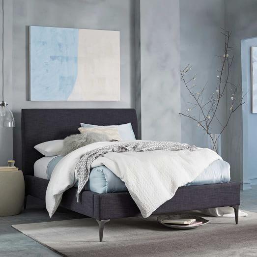 dark gray linen upholstered bed