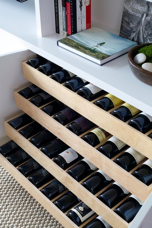 Amazing Living Room Features Built In Shelves And Cabinets Fitted With Pull Out Wine
