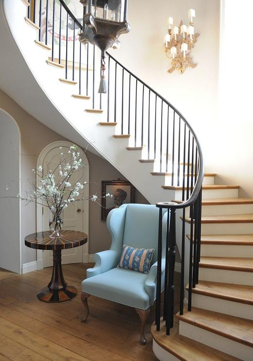 Shelves and table under staircase wall transitional for Round staircase designs interior