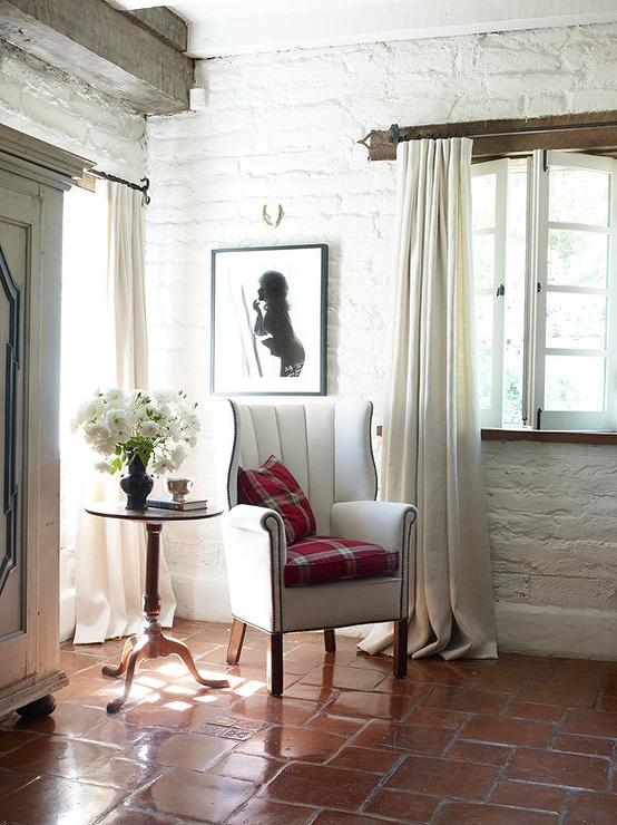 Reading Corner With White Wingback Chair And Terracotta