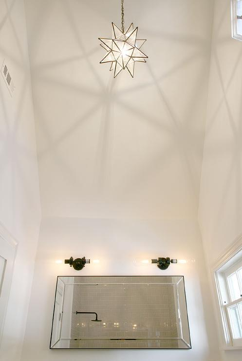 White bathroom with vaulted ceiling and glass moravian star pendant white bathroom with vaulted ceiling and glass moravian star pendant aloadofball