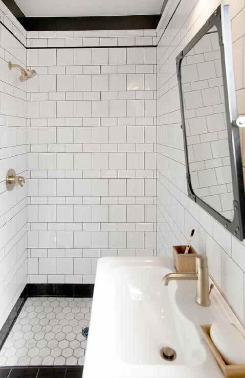 Interior design inspiration photos by matters of space for Black tile bathroom designs