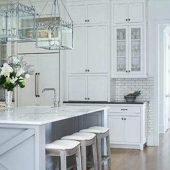 White Kitchen With Gray Center Island And Backless Gray