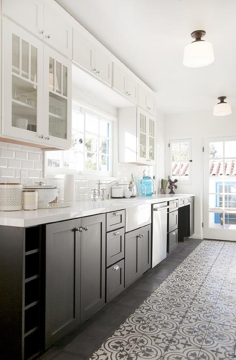 White And Black Kitchen With Glass Upper Cabinets And Black Lower
