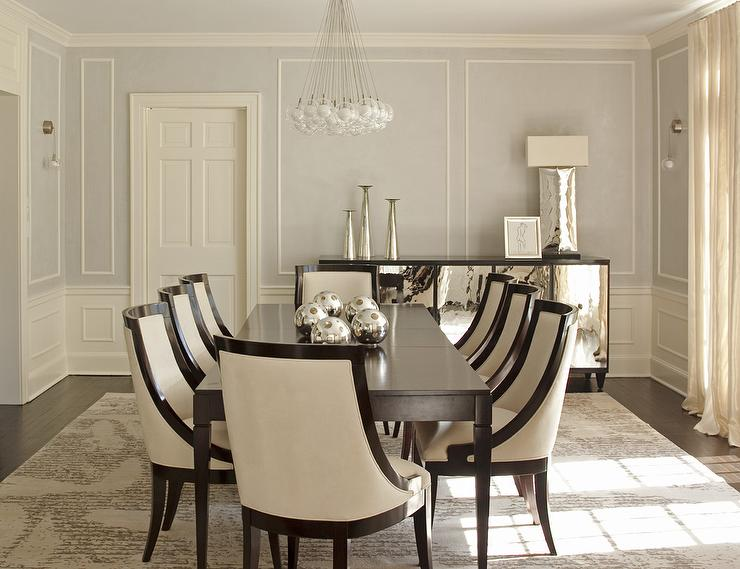 Elegant Dining Room Features Top Part Of Walls Painted Pale Gray Lined With Decorative Trim Moldings And Bottom Wall Clad In Wainscoting