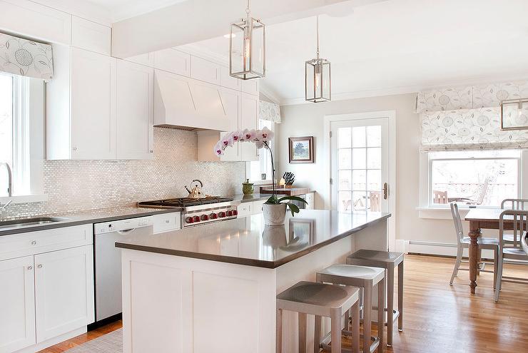 White Kitchen With Gray Quartz Countertops And A White