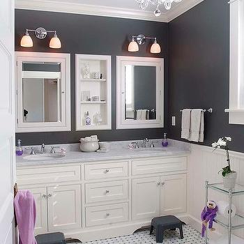 white and black girls bathroom with purple accents