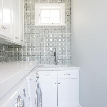 galley style laundry room with farmhouse sink