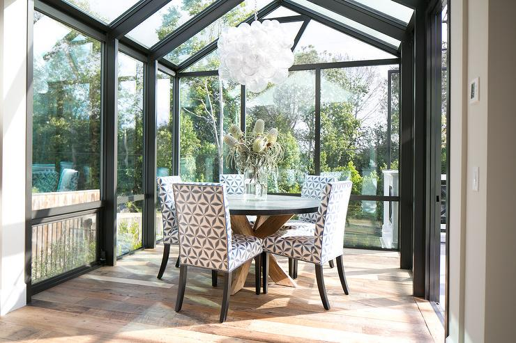 Sunroom Dining Room With Vaulted Glass Ceiling